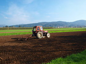 A tractor harrowing an acre.
